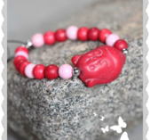a439-1 Buddha rött armband i sten